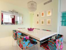 Floral Chairs and Glass Accents in Modern Dining Room