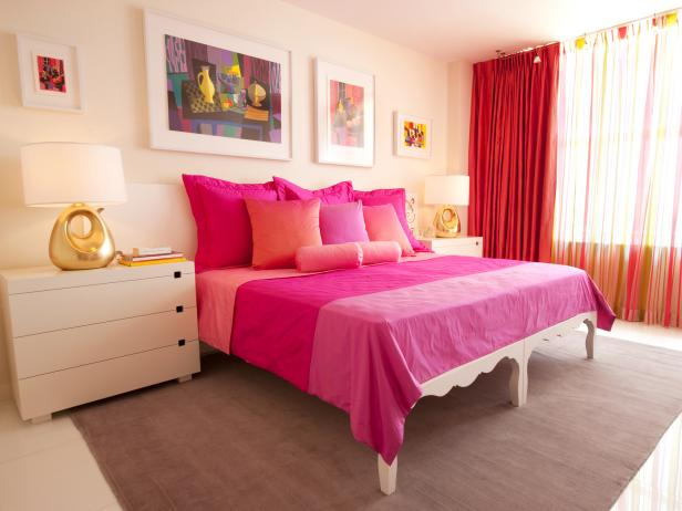 White Bedroom With Hot-Pink Bedding, Multicolor Artwork and Gold Lamps