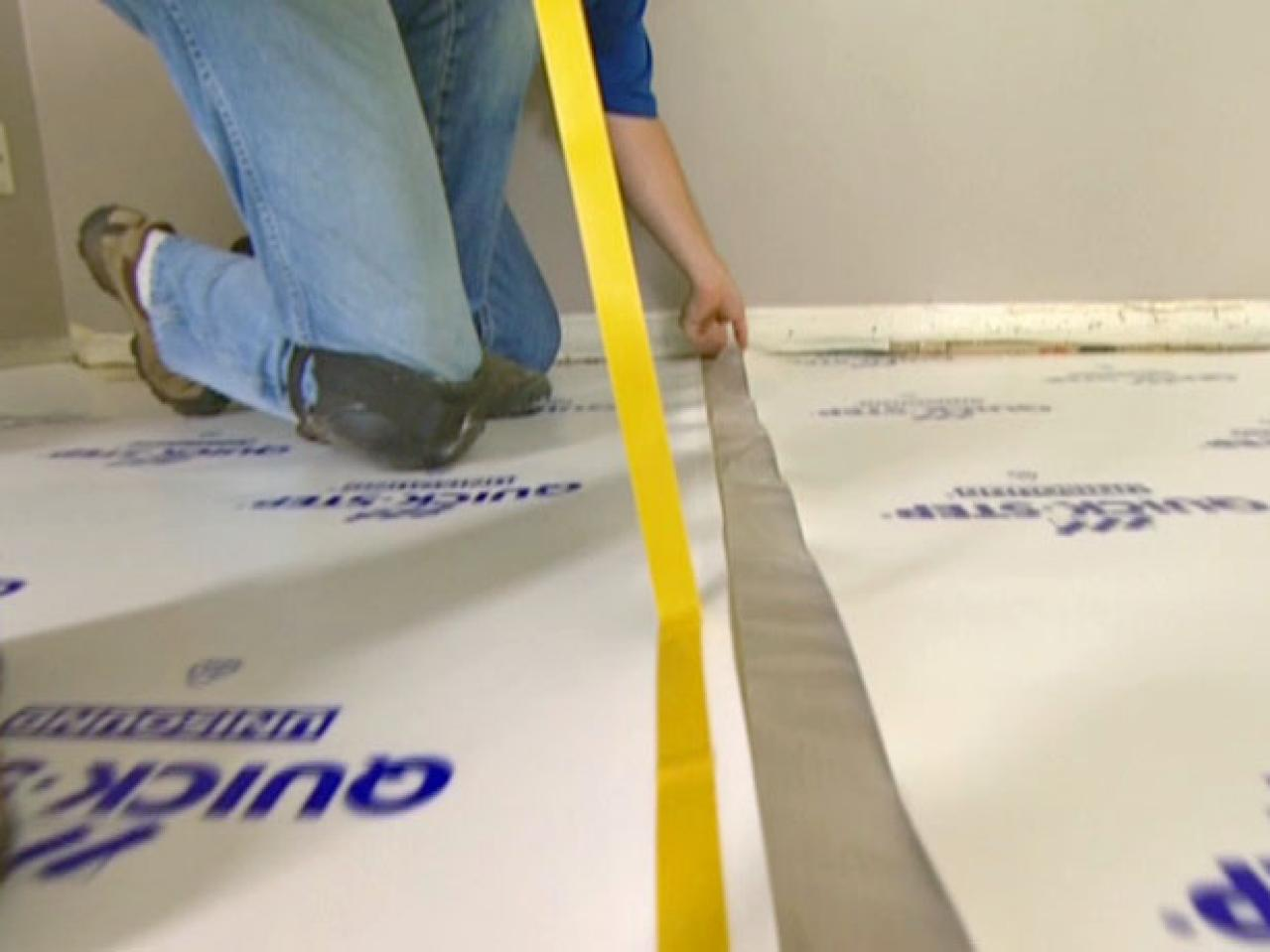 How to install underlayment and laminate flooring hgtv for Diy laminate flooring