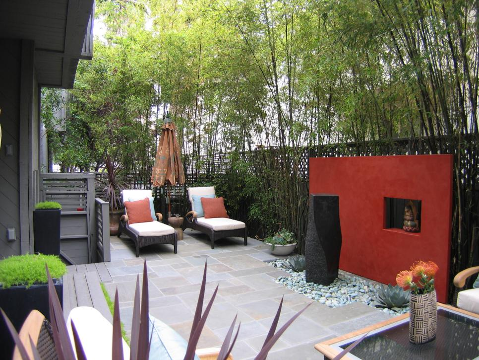 beautiful walls and fences for outdoor spaces outdoor spaces patio ideas decks gardens hgtv