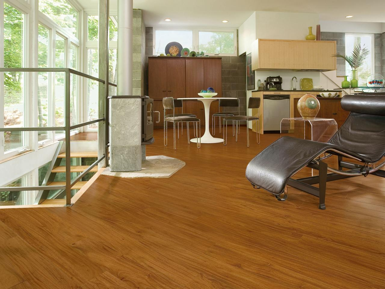 Flooring trends hgtv vinyl in demand modern open kitchen with faux wood flooring dailygadgetfo Gallery
