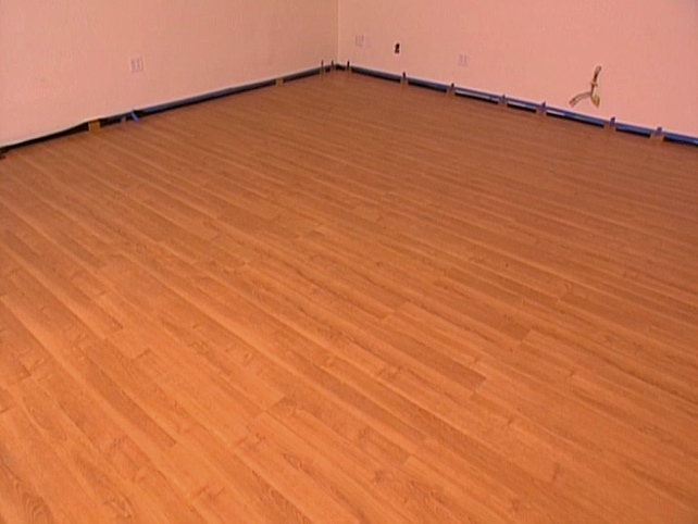 Snap together laminate flooring