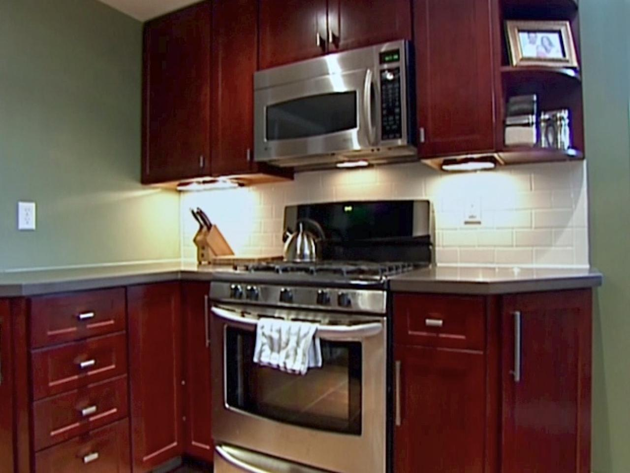 Kitchen catch up how to install cabinets hgtv for Diy kitchen cabinets