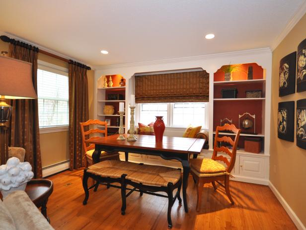 Traditional Dining Room With Hardwood Floors and Built-in Bookcases