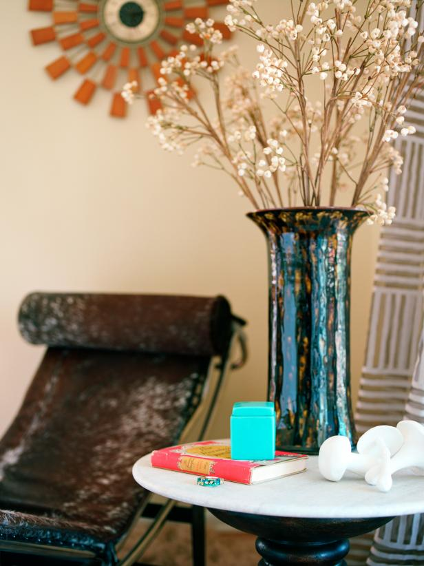 Blue Vase Holding Baby's Breath on Eclectic Side Table