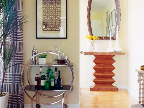 Eclectic Foyer With Round Bar Cart