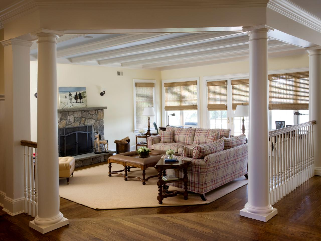traditional living room with columns this step down living room offers