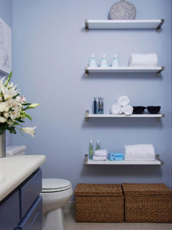 Blue Bathroom With Floating Shelves