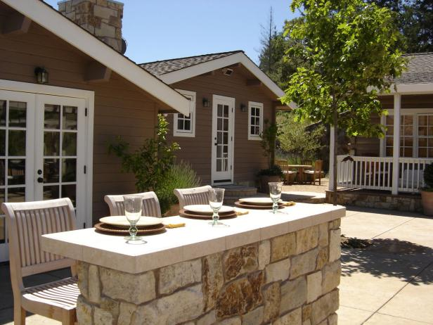 Stone Bar With Three Barstools in Cottage Courtyard
