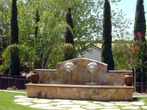 Stone Lion Fountain With Flagstone Patio