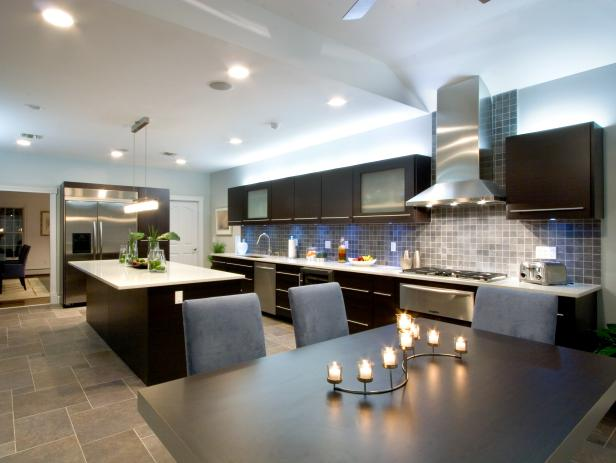 Eat-In Kitchen With Modern Black Cabinets and Gray Tile Backsplash