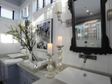 Elegant White Bathroom With Black Mirror