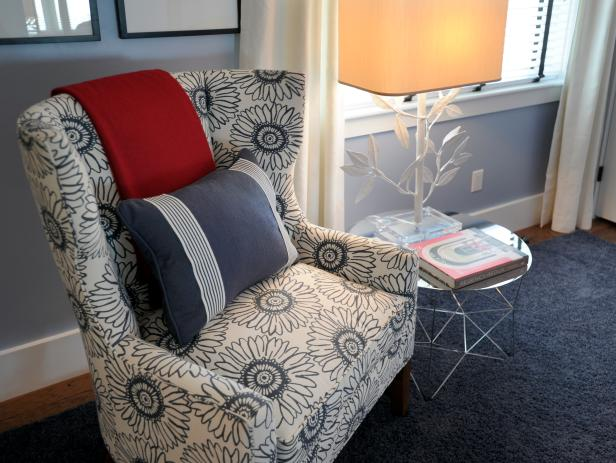Wingback Chair With Flower Pattern and White Lamp on Glass End Table