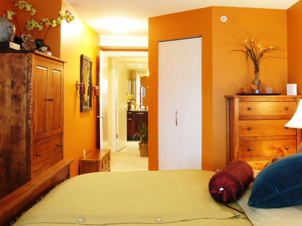 Orange Bedroom with Wood Furniture