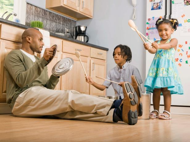 Family Plays in Kitchen With Pots and Pans