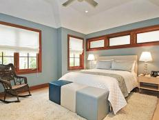 Blue Bedroom With Mahogany-Framed Windows