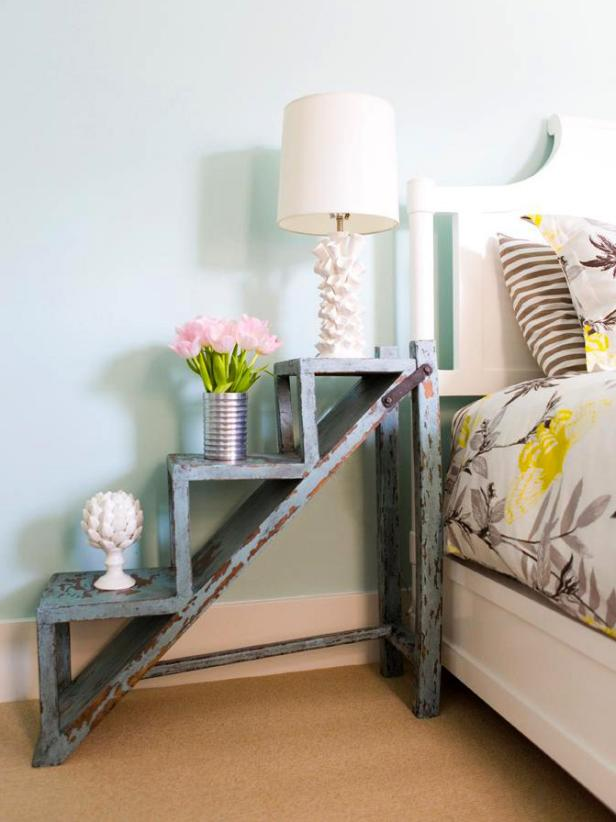Blue Bedroom With Weathered Wooden Garden Steps as Bedside Table