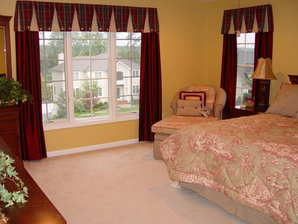 Yellow Bedroom with Red Window Treatments