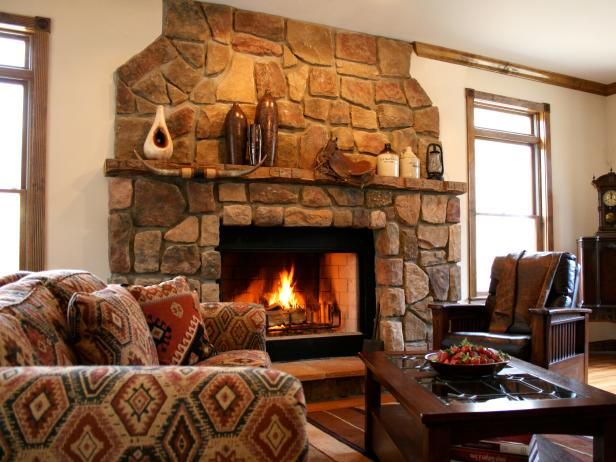 Neutral Living Room With Stone Fireplace and Patterned Chair