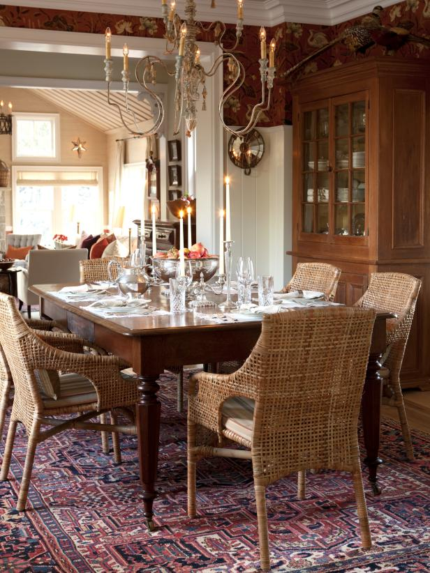 Traditional Dining Room With Wicker Seating, Formal Chandelier, Hutch