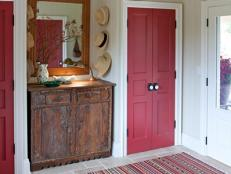 Cottage Mudroom With Cranberry-Red Closets