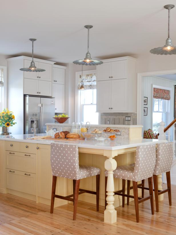 White Kitchen with Yellow Kitchen Island and Pendant Lights