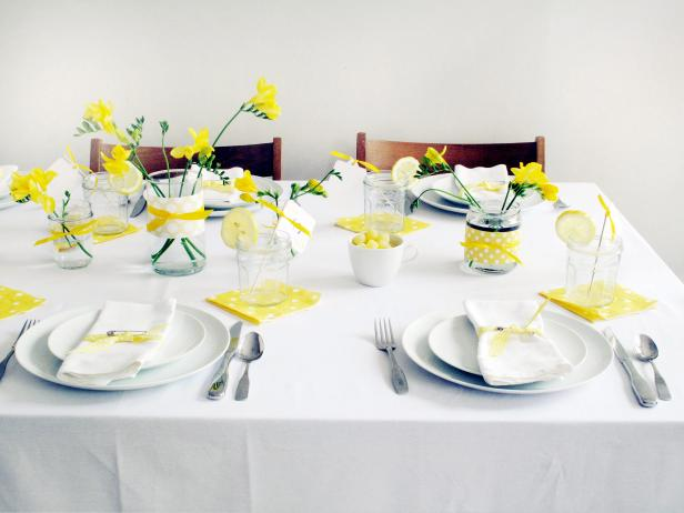 Yellow and white baby shower brunch hgtv Baby shower table setting