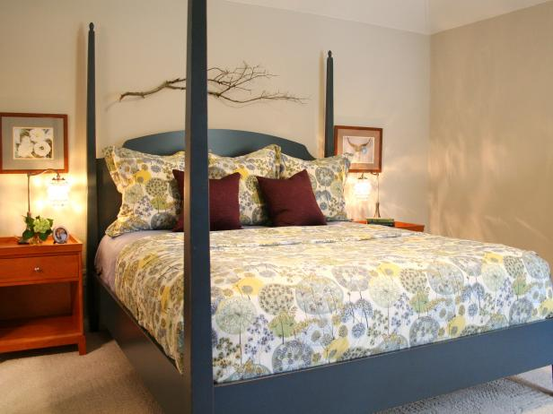 Blue Four-Poster Bed With Orange Nightstands