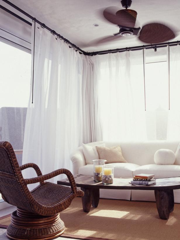 Casual Sitting Area With White Curtains