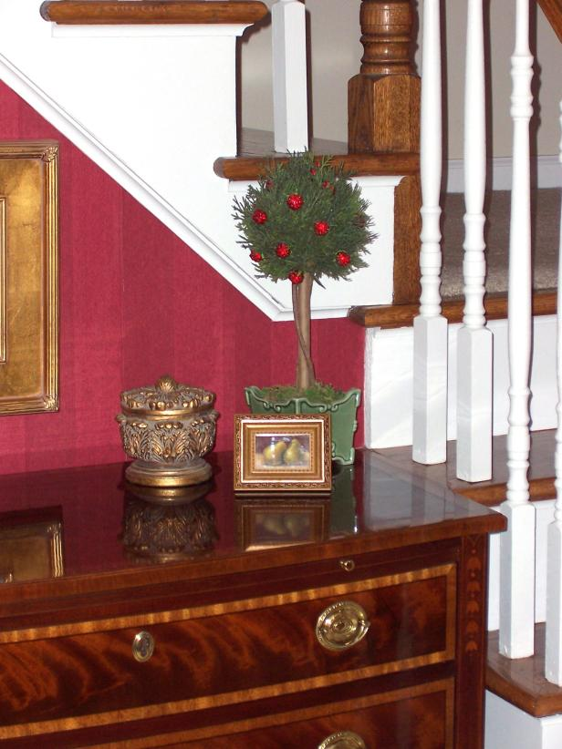 Traditional Foyer With Wood Dresser and Accessories