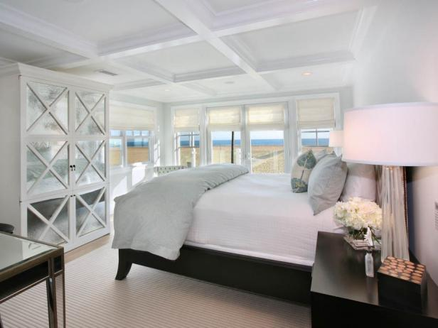 Master Bedroom with Glass Hutch and Large White Bed