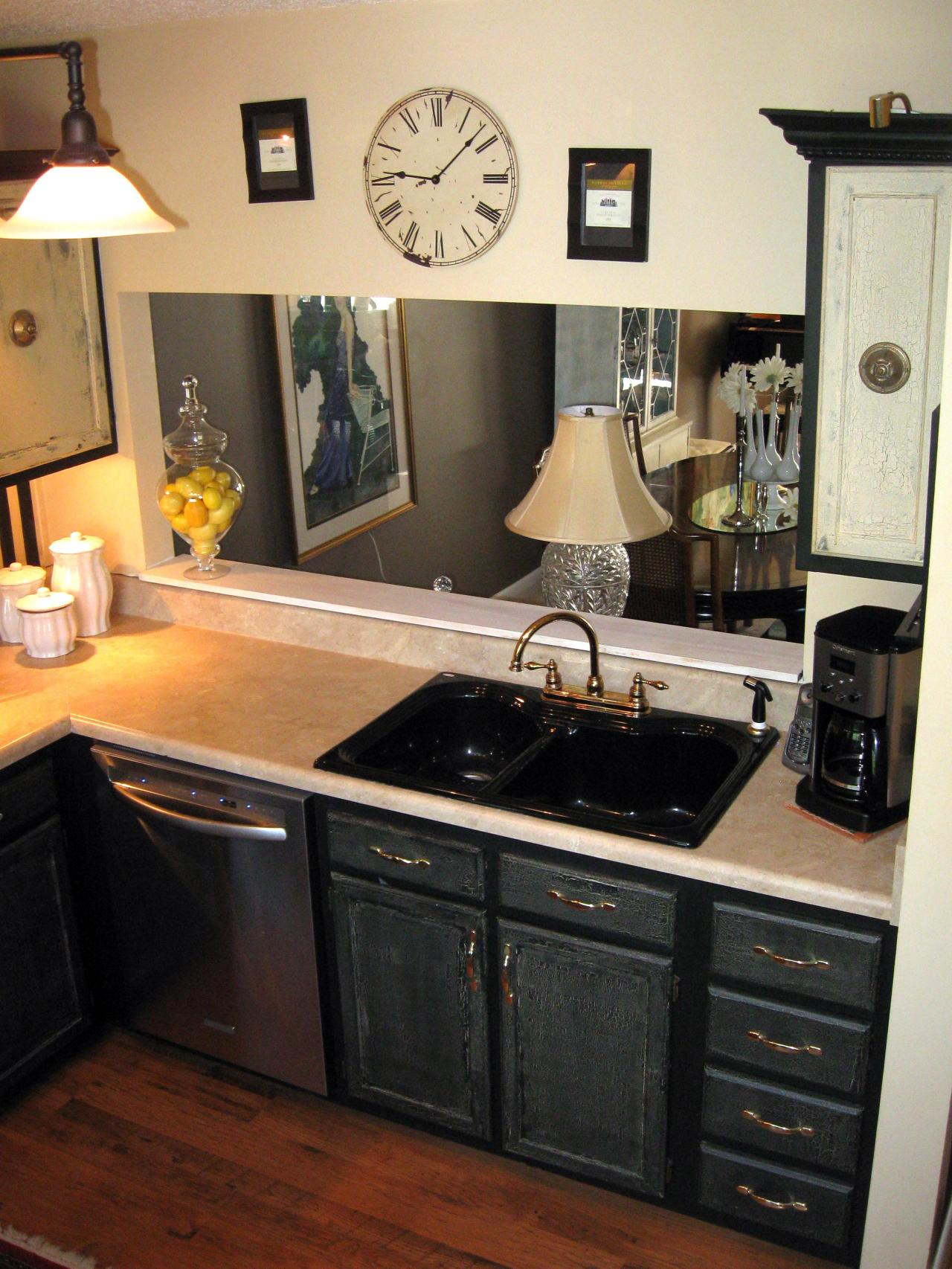 Photos hgtv - Black kitchen cabinets small kitchen ...