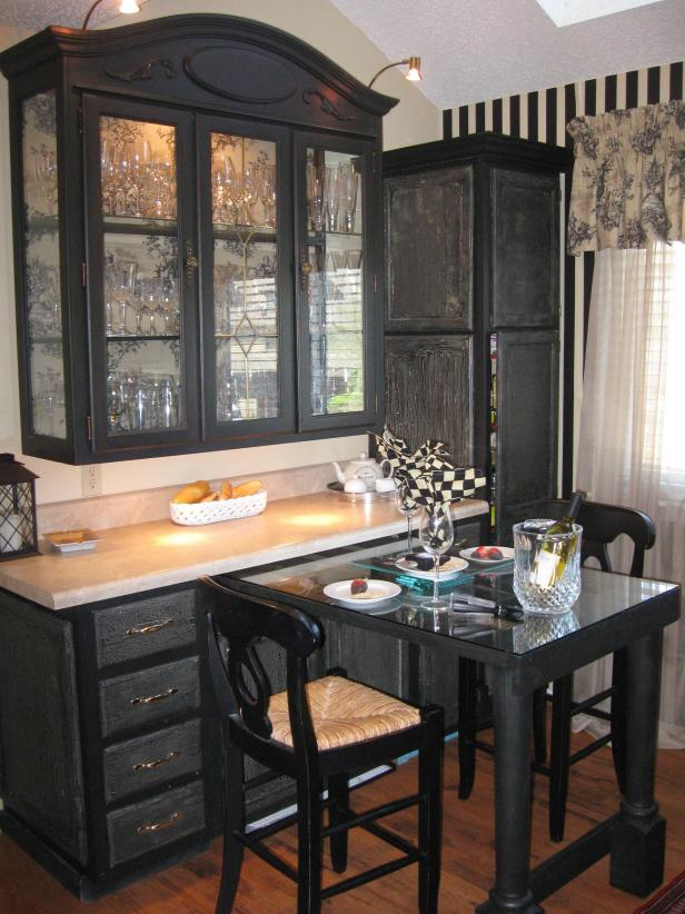 french country breakfast nook with black hutch toile wallpaper
