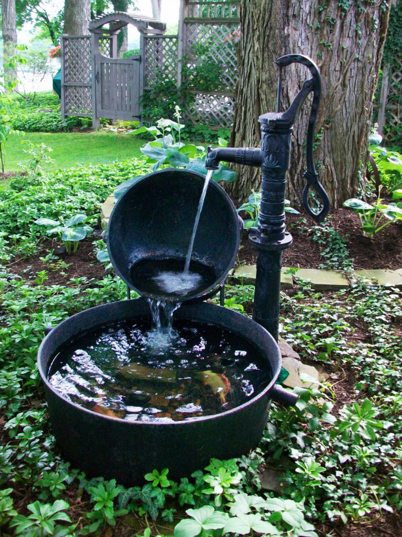 10 refreshing container water features landscaping ideas for Garden fountains and water features
