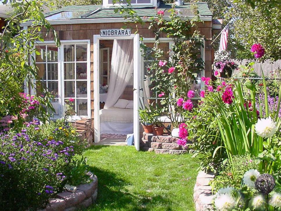 Charming garden retreats hgtv for Backyard cottage shed