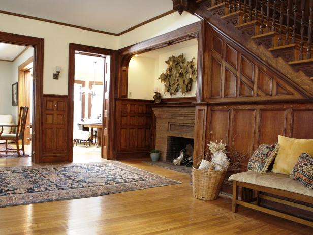 Wood Paneled Foyer with Fireplace and Modern Art
