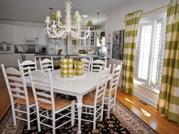 Open Plan Kitchen With White Dining Table, Chairs and Chandelier