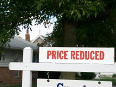 Real Estate Yard Sign Announces Price Reduced