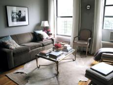 Suede Couch and Animal Skin Rug Cozy Up a Gray Living Room