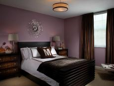 Purple and Brown Bedroom With Sunburst Mirror