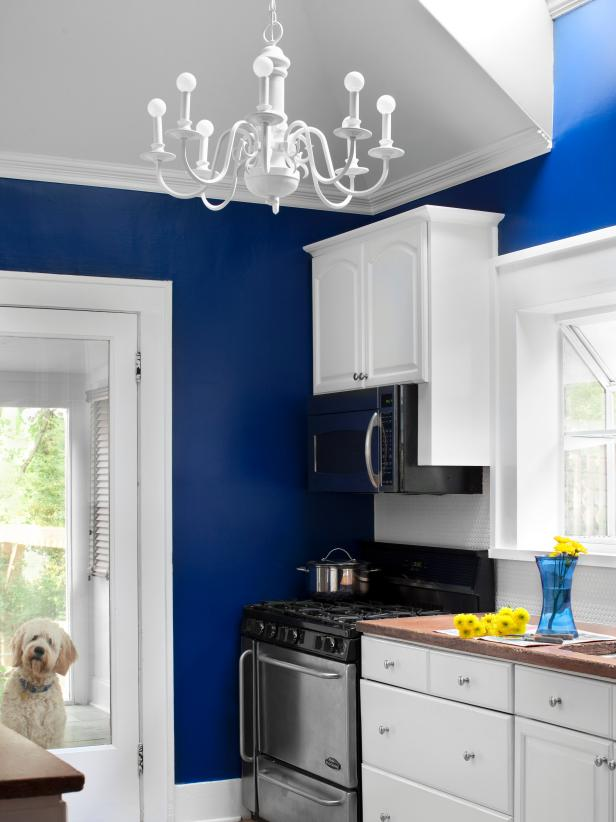 White Kitchen With Bright Blue Walls