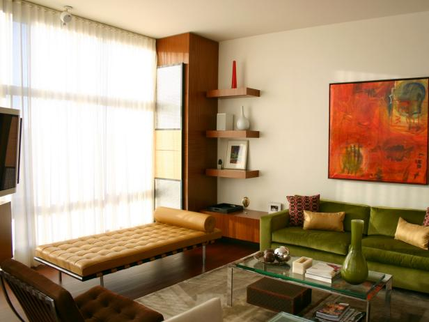 Mid-Century Modern Living Room With Green Velvet Sofa and Leather Chaise