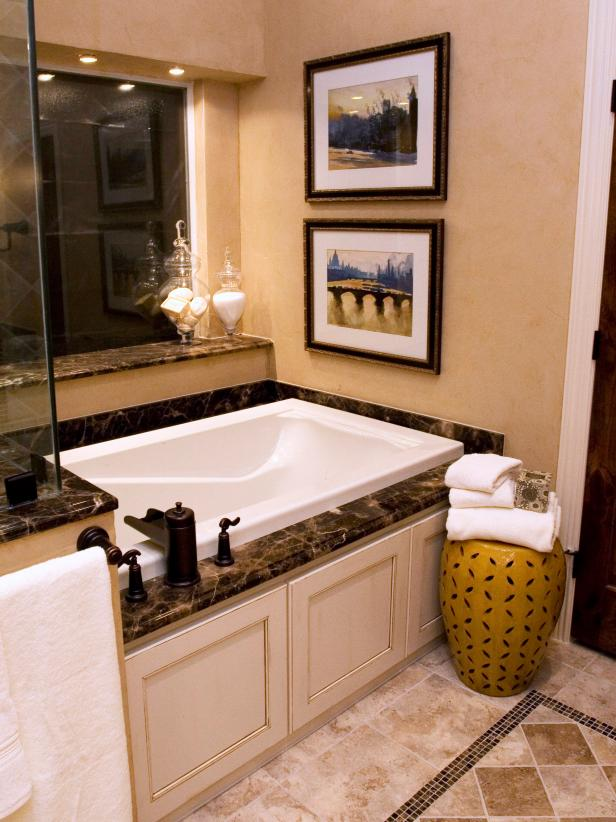 Cozy Granite Trimmed Bathtub With Neutral Tile Floor