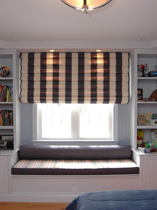 Cozy Kids' Room Window Seat and Built-In Bookcases