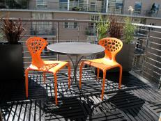 Urban Metal Balcony With Modern Orange Chairs