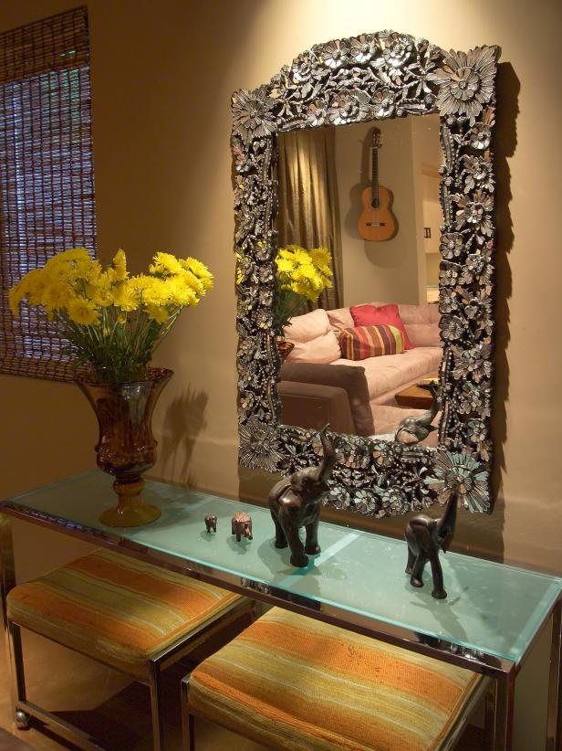 Elegant Mirror and Frosted Glass Table and Yellow Flowers