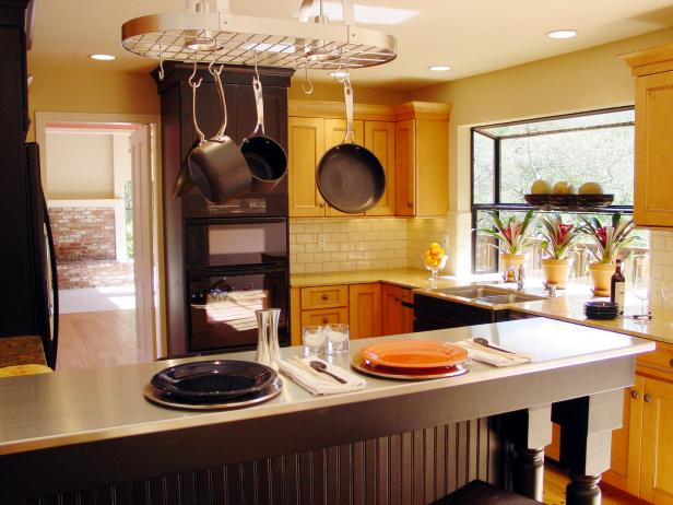Vibrant Yellow Kitchen With Eat-In Peninsula