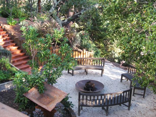 Outdoor Round Fire Pit Surrounded by Curved Benches in Garden Setting
