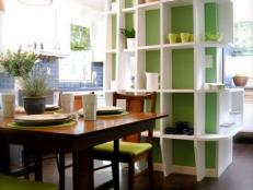 Shelves Act As Room Divider Between Kitchen And Dining Room