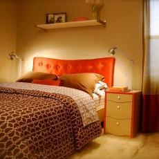 Modern Master Bedroom With Vibrant Orange Headboard